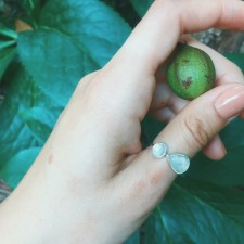 A ring that we literally dreamt up! A sideways teardrop moonstone paired with a circle moonstone, and handset on a sterling silver ring band.