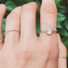 A twist on our stone stacking ring, we added an arc. A circle moonstone paired with an arced band, and handset on a sterling silver ring band.